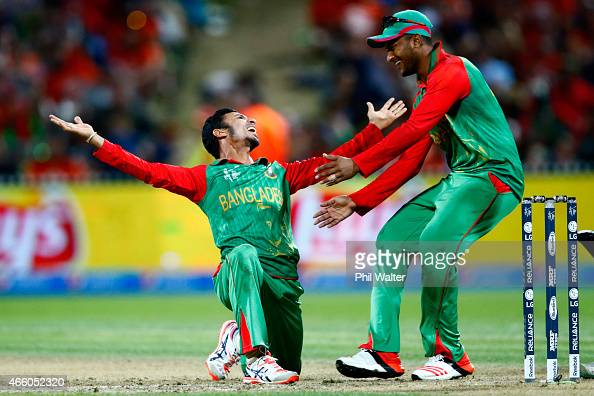 Nasir Hossain of Bangladesh celebrates his wicket of Ross Taylor of New Zealand with Shakib Al Hasan during the 2015 ICC Cricket World Cup match...