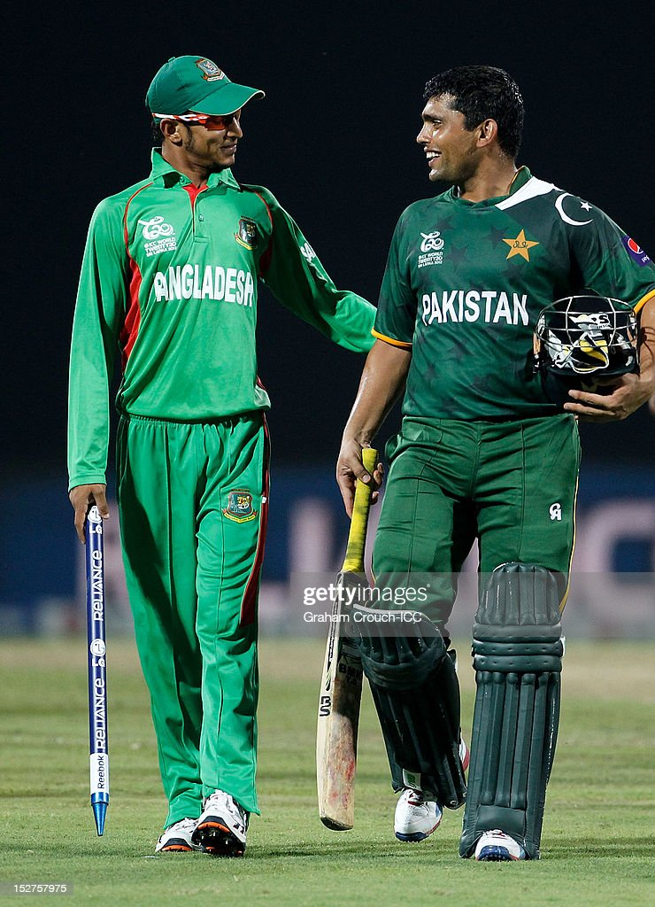 <a gi-track='captionPersonalityLinkClicked' href=/galleries/search?phrase=Nasir+Hossain&family=editorial&specificpeople=4879926 ng-click='$event.stopPropagation()'>Nasir Hossain</a> of Bangladesh (left) congratulates <a gi-track='captionPersonalityLinkClicked' href=/galleries/search?phrase=Kamran+Akmal&family=editorial&specificpeople=221679 ng-click='$event.stopPropagation()'>Kamran Akmal</a> of Pakistan after the Group D match between Pakistan and Bangladesh at Pallekele Cricket Stadium on September 25, 2012 in Kandy, Sri Lanka.