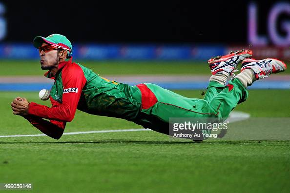 Nasir Hossain of Bangladesh dives and drop the catch to dismiss Daniel Vettori of New Zealand during the 2015 ICC Cricket World Cup match between...