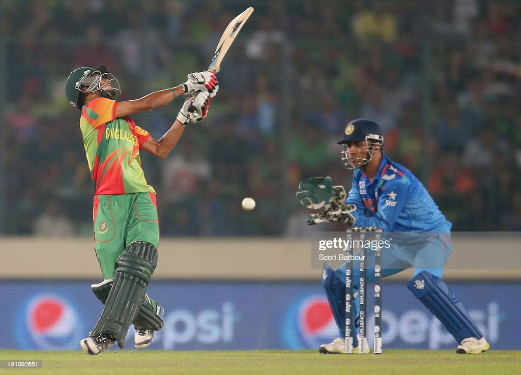 <a gi-track='captionPersonalityLinkClicked' href=/galleries/search?phrase=Nasir+Hossain&family=editorial&specificpeople=4879926 ng-click='$event.stopPropagation()'>Nasir Hossain</a> of Bangladesh swings and misses and is out stumped by MS Dhoni of India during the ICC World Twenty20 Bangladesh 2014 match between Bangladesh and India at Sher-e-Bangla Mirpur Stadium on March 28, 2014 in Dhaka, Bangladesh.