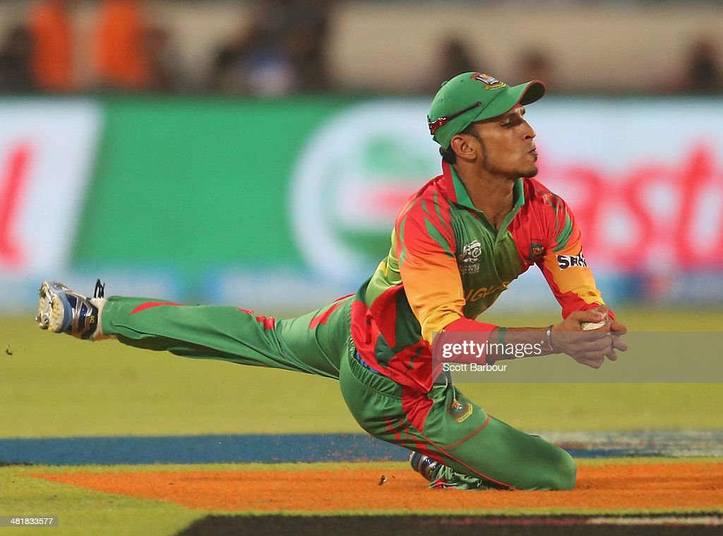 <a gi-track='captionPersonalityLinkClicked' href=/galleries/search?phrase=Nasir+Hossain&family=editorial&specificpeople=4879926 ng-click='$event.stopPropagation()'>Nasir Hossain</a> of Bangladesh takes a catch to dismiss Aaron Finch of Australia during the ICC World Twenty20 Bangladesh 2014 match between Bangladesh and Australia at Sher-e-Bangla Mirpur Stadium on April 1, 2014 in Dhaka, Bangladesh.