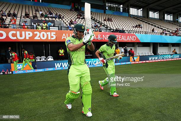 Nasir Jamshed and Ahmad Shahzad of Pakistan head out to bat during the 2015 ICC Cricket World Cup match between Pakistan and the United Arab Emirates...