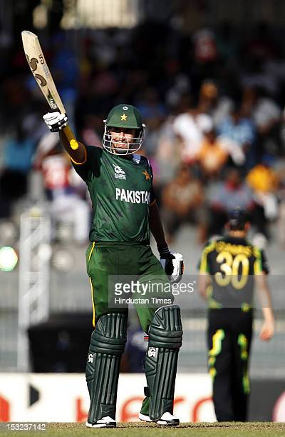 Nasir Jamshed of Pakistan raises his bat after his 50 during the ICC T20 World Cup Super Eight group 2 cricket match between Australia and Pakistan...