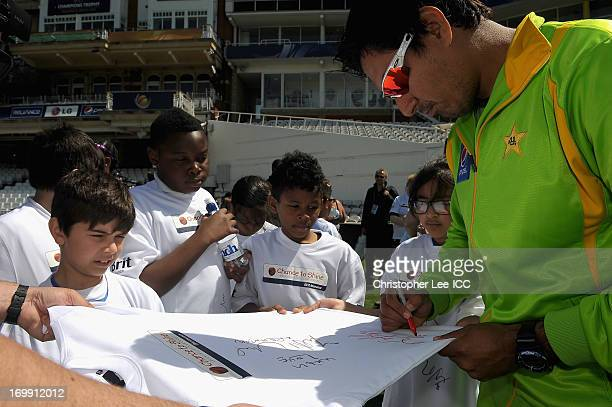 Nasir Jamshed of Pakistan signs autograph's for fans as members of the Pakistan Team take part in the ICC Chance to Shine programme at The Oval on...