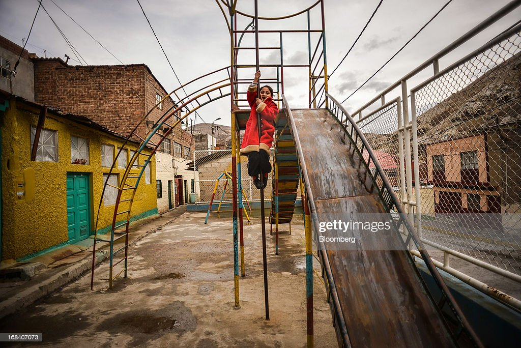 Nasira Chavez, an 9-year-old whose blood contained 55 micrograms per deciliter of lead when she was 2 years-old, slides down a pole on a playground in the town of La Oroya, Peru, on Wednesday, March 20, 2013. Most of La Oroyaís children suffer elevated lead levels, according to the Peruvian government. The question of responsibility for lead pollution in La Oroya is at the center of high-stakes clash between Peru and U.S. billionaire Ira Rennert, who owned Doe Run Peru for more than a decade through Renco Group Inc., a metals, mining and industrial conglomerate based in New York that has said it is not responsible for the childrenís ills. Photographer: Meridith Kohut/Bloomberg via Getty Images