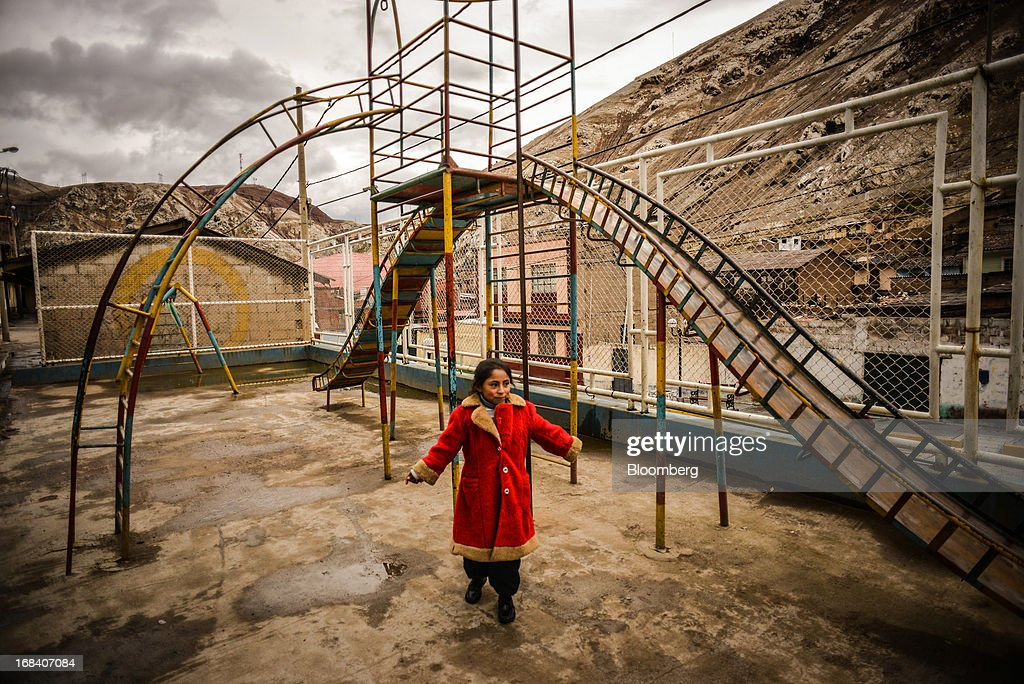 Nasira Chavez, an 9-year-old whose blood contained 55 micrograms per deciliter of lead when she was 2 years-old, stands for a portrait on a playground in the town of La Oroya, Peru, on Wednesday, March 20, 2013. Most of La Oroyaís children suffer elevated lead levels, according to the Peruvian government. The question of responsibility for lead pollution in La Oroya is at the center of high-stakes clash between Peru and U.S. billionaire Ira Rennert, who owned Doe Run Peru for more than a decade through Renco Group Inc., a metals, mining and industrial conglomerate based in New York that has said it is not responsible for the childrenís ills. Photographer: Meridith Kohut/Bloomberg via Getty Images