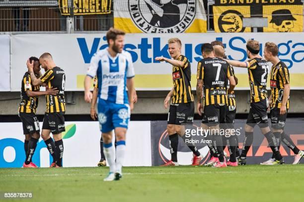 Nasiru Mohammed of BK Hacken celebrates with teammates after scoring 11 and Emil Salomonsson of IFK Goteborg dejected during the Allsvenskan match...
