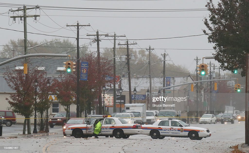 Nassau County Police detour traffic off Merrick Road due to flooding caused by Hurricane Sandy on October 29, 2012 in Freeport, New York.The storm, which threatens 50 million people in the eastern third of the U.S., is expected to bring days of rain, high winds and possibly heavy snow.