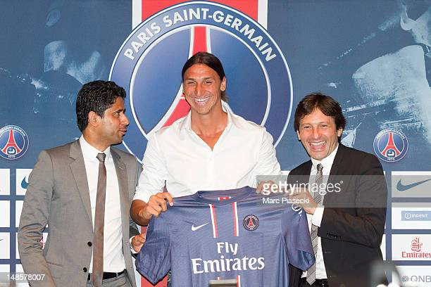 Nasser Al Khelaifi and Leonardo Nascimento de Araújo welcome Zlatan Ibrahimovic during the press conference for Paris Saint Germain at Parc des...
