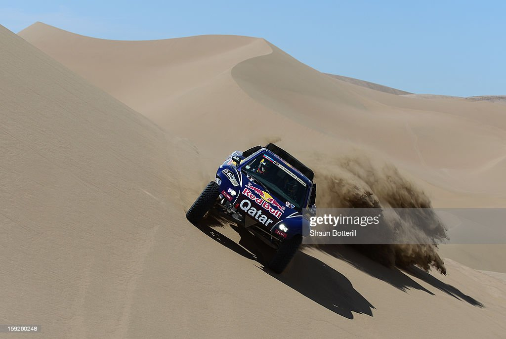 Nasser Al-Attiyah and co-driver Lucas Cruz of team Buggy compete in stage 6 from Arica to Calama during the 2013 Dakar Rally on January 10, 2013 in Arica, Chile.