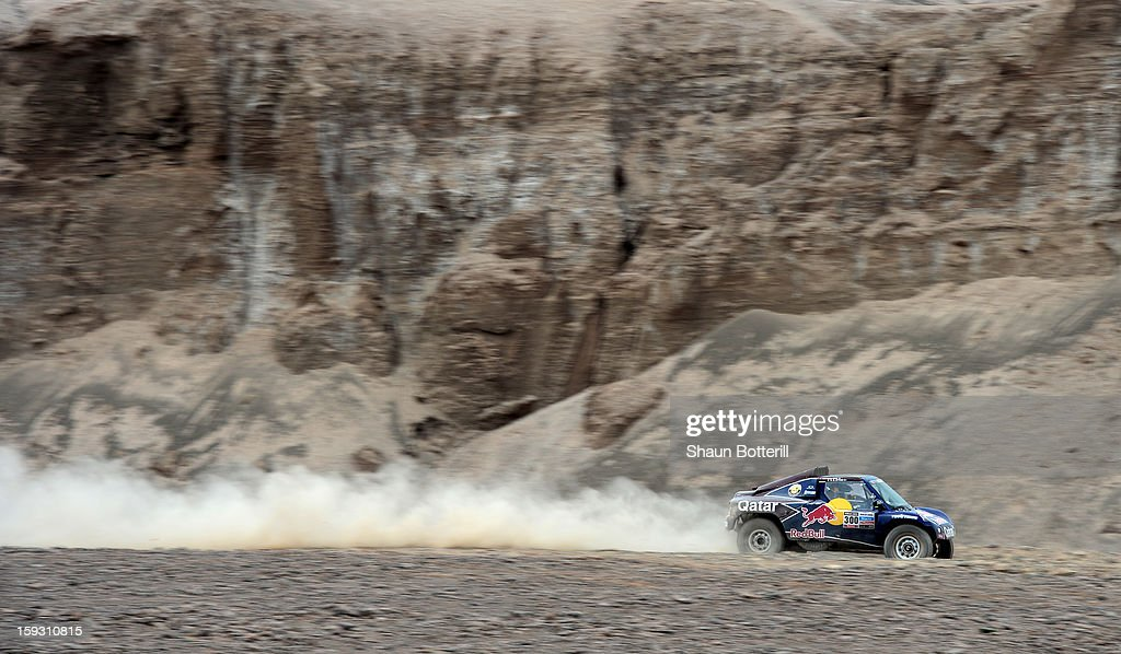 Nasser Al-Attiyah and co-driver LucasCruz of team Buggy compete in stage 6 from Arica to Calama during the 2013 Dakar Rally on January 10, 2013 in Arica, Chile.