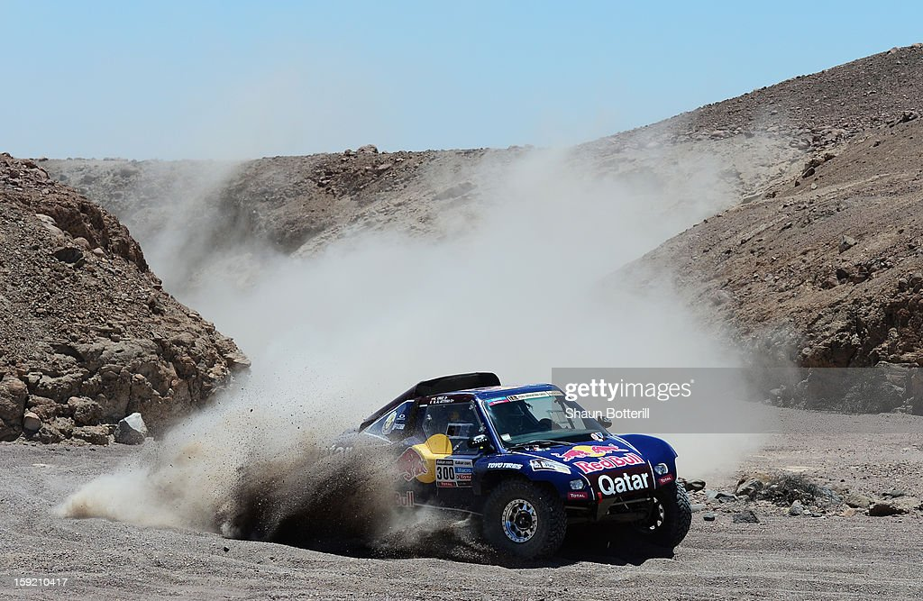 <a gi-track='captionPersonalityLinkClicked' href=/galleries/search?phrase=Nasser+Al-Attiyah&family=editorial&specificpeople=2247125 ng-click='$event.stopPropagation()'>Nasser Al-Attiyah</a> and co-pilot <a gi-track='captionPersonalityLinkClicked' href=/galleries/search?phrase=Lucas+Cruz&family=editorial&specificpeople=6669670 ng-click='$event.stopPropagation()'>Lucas Cruz</a> of team Buggy compete in stage 5 from Arequipa to Arica during the 2013 Dakar Rally on January 9, 2013 in Arequipa, Peru.