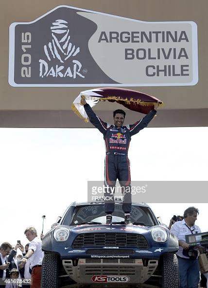 Nasser AlAttiyah from Qatar celebrates on the podium of the 2015 Rally Dakar in Buenos Aires Argentina on January 17 2015 AlAttiyah won the Dakar...