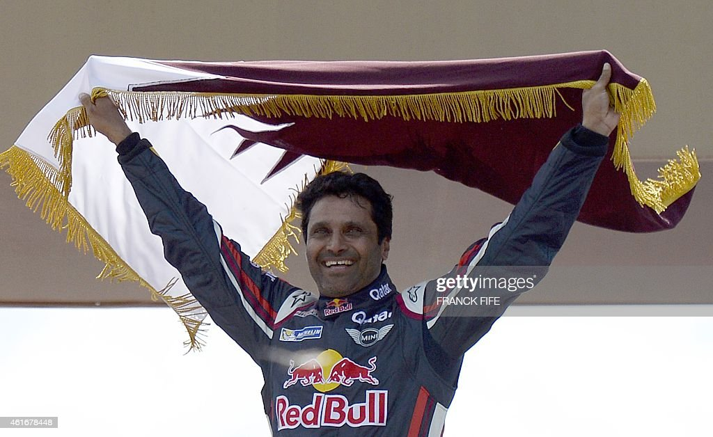 Nasser AlAttiyah from Qatar celebrates on the podium of the 2015 Rally Dakar in Buenos Aires Argentina on January 17 2015 AlAttiyah won the Dakar...
