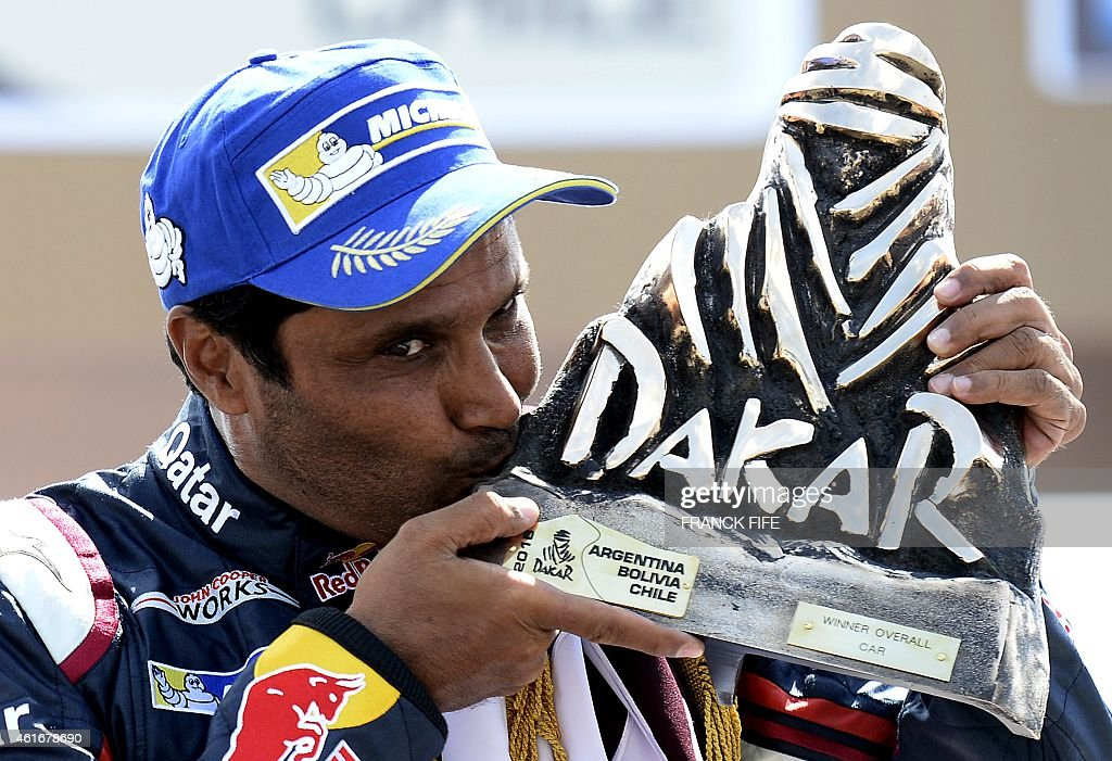 Nasser AlAttiyah fromQatar kisses the trophy on the podium of the 2015 Rally Dakar in Buenos Aires Argentina on January 17 2015 AlAttiyah won the...