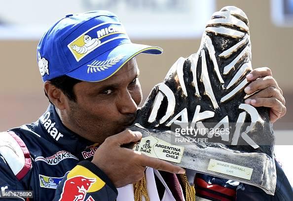 Nasser AlAttiyah fromQatar kisses the trophy on the podium of the 2015 Rally Dakar in Buenos Aires Argentina on January 17 2015 AlAttiyah won the...