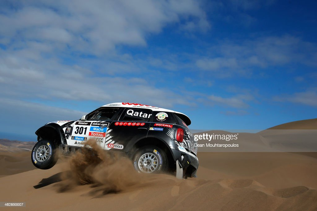 Nasser AlAttiyah of Qatar and Lucas Cruz of Spain for MINI compete in stage 10 on the way to Antofagasta during Day 11 of the 2014 Dakar Rally on...
