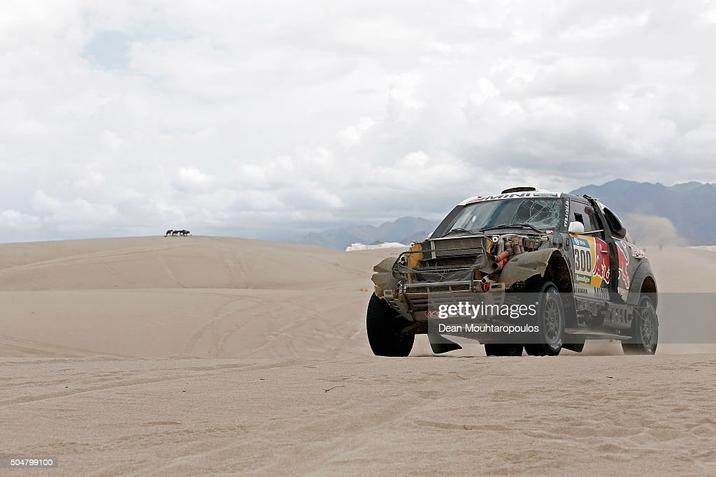 <a gi-track='captionPersonalityLinkClicked' href=/galleries/search?phrase=Nasser+Al-Attiyah&family=editorial&specificpeople=2247125 ng-click='$event.stopPropagation()'>Nasser Al-Attiyah</a> of Qatar and Matthieu Baumel of France in the MINI ALL4 RACING for AXION X-RAID TEAM compete on day 11 stage ten between Belen and La Rioja during the 2016 Dakar Rally on January 13, 2016 in near Fiambala, Argentina.