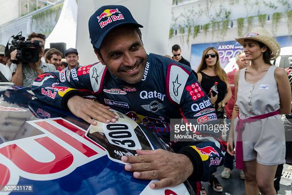 Nasser AlAttiyah of Qatar and Mini poses for pictures next to his car during the presentation of Team Mini for Rally Dakar 2016 on December 30 2015...