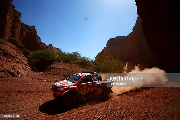 Nasser AlAttiyah of Qatar and Toyota Gazoo Racing drives with codriver Matthieu Baumel of France in the Hilux Toyota car in the Classe T13 2 Roues...