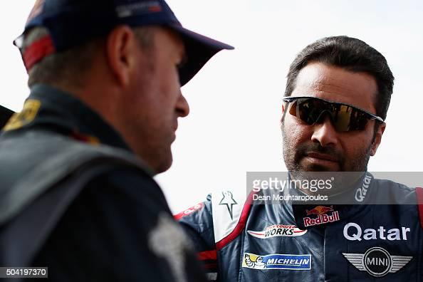 Nasser AlAttiyah of Qatar in the MINI ALL4 RACING for AXION XRAID TEAM and Stephane Peterhansel of France the PEUGEOT 2008 DKR for TEAM PEUGEOT TOTAL...
