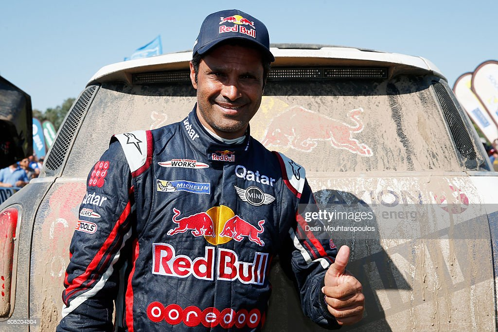 <a gi-track='captionPersonalityLinkClicked' href=/galleries/search?phrase=Nasser+Al-Attiyah&family=editorial&specificpeople=2247125 ng-click='$event.stopPropagation()'>Nasser Al-Attiyah</a> of Qatar in the MINI ALL4 RACING for AXION X-RAID TEAM celebrates 2nd in the overall race as he arrives at the end of stage thirteen between Villa Carlos Paz and Rosario on day fourteen of the 2016 Dakar Rally on January 16, 2016 Rio Cuarto, Argentina.