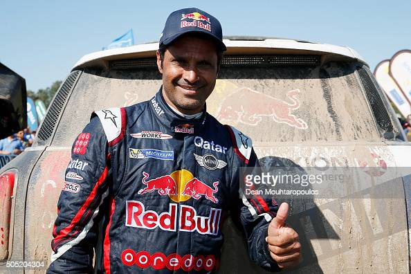 Nasser AlAttiyah of Qatar in the MINI ALL4 RACING for AXION XRAID TEAM celebrates 2nd in the overall race as he arrives at the end of stage thirteen...
