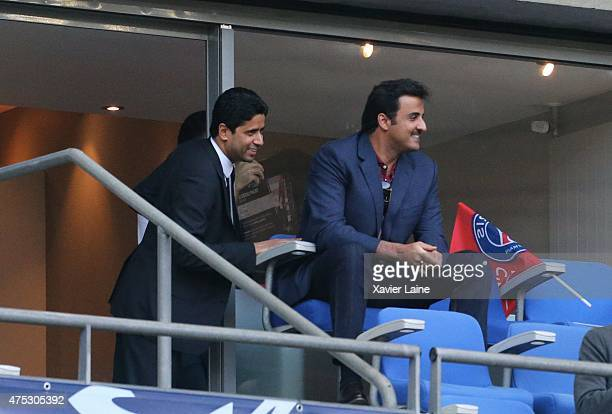 Nasser AlKhelafi and Tamim ben Hamad Al Thani react during the French Cup Final between AJ Auxerre and Paris SaintGermain FC at Stade de France on...