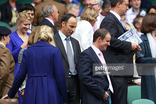 Nasser Hussain and Andrew Strauss make their way to their seats prior to first round match between Serena Williams of the United States and Aravane...