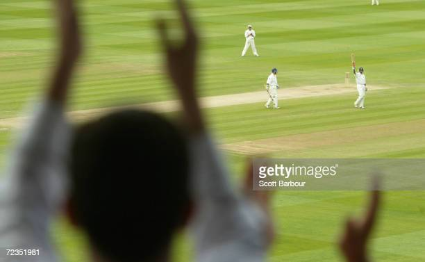 Nasser Hussain of England accepts the crowds applause after reaching his century during the fifth day of the first npower test match between England...