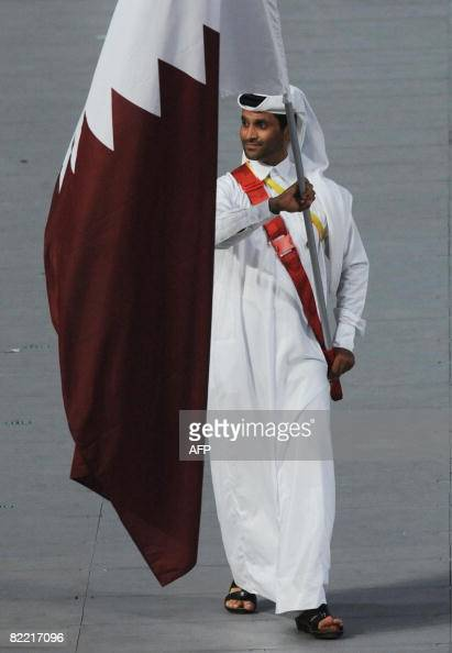Nasser Saleh AlAttiya Qatar's flag bearer parades in front of his delegation during the 2008 Beijing Olympic Games opening ceremony on August 8 2008...