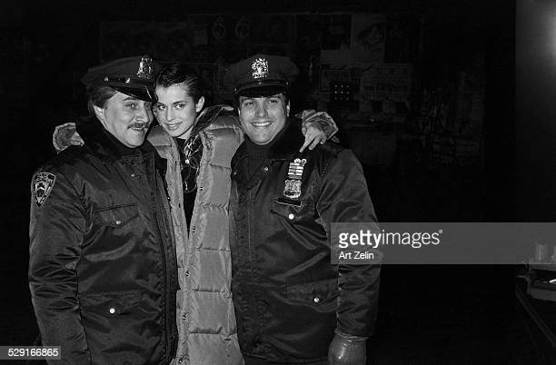 Nastassja Kinski posing with 2 security guards circa 1970 New York