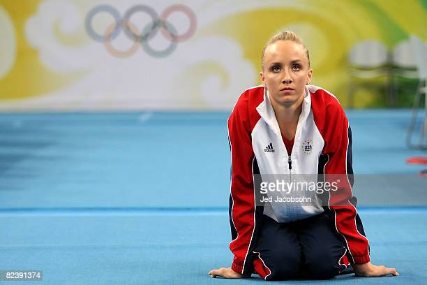 Nastia Liukin of the United States stretches in preperation of competing in the women's individual floor final in the artistic gymnastics event held...