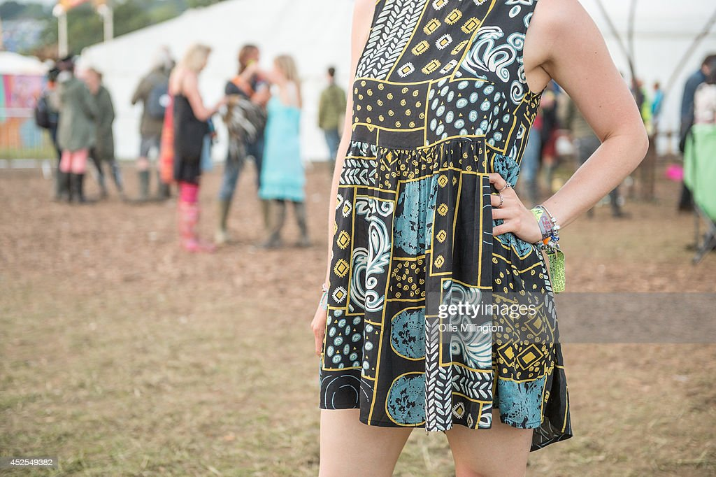 Nat 21, a student from London wearing a dress from Topshop, Hunter wellies and RayBan Sunglasses on the last day of the Glastonbury Festival at Worthy Farm on June 29, 2014 in Glastonbury, England.