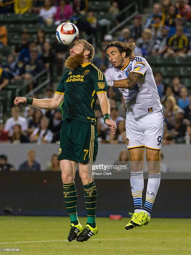 Nat Borchers (7) of Portland Timbers beats <a gi-track='captionPersonalityLinkClicked' href=/galleries/search?phrase=Alan+Gordon+-+Soccer+Player&family=editorial&specificpeople=11667134 ng-click='$event.stopPropagation()'>Alan Gordon</a> (9) of Los Angeles Galaxy to a header during Los Angeles Galaxy's MLS match against Portland Timbers at the StubHub Center on June 24, 2015 in Carson, California. The LA Galaxy won the match 5-0