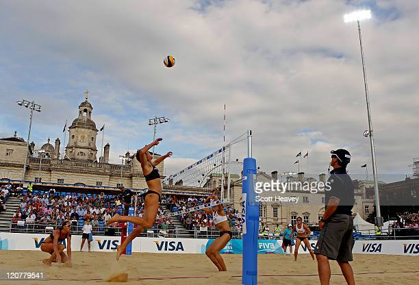 Nat Cook of Australia smashes the ball during the Preliminary Phase Pool E match between Australia and Malaysia in action during the VISA FIVB Beach...