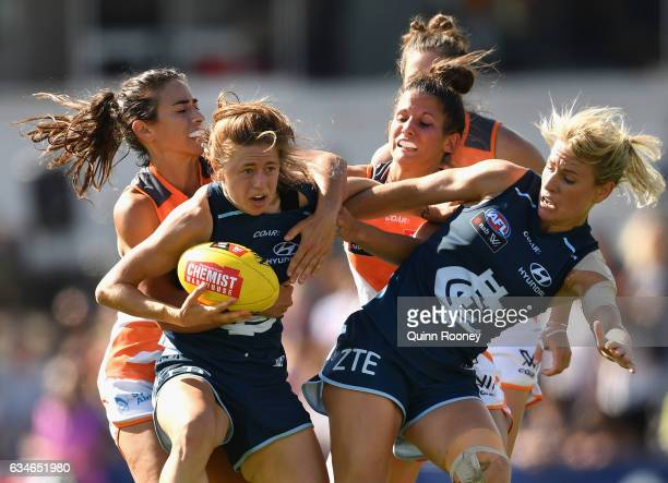 Nat Exon of the Blues is tackled during the round two AFL Women's match between the Carlton Blues and the Greater Western Sydney Giants at Ikon Park...