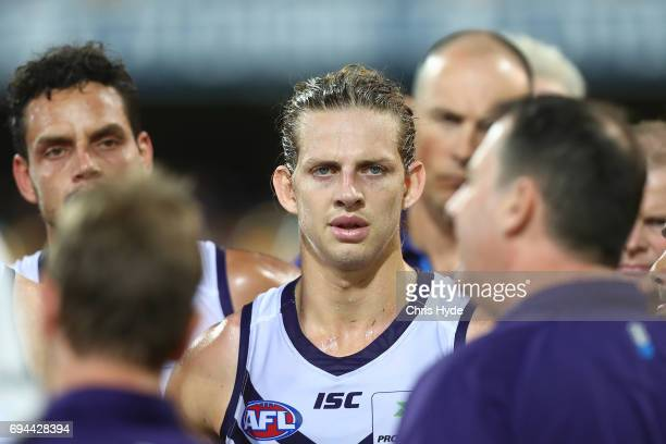 Nat Fyfe looks on while Dockers coach Ross Lyon talks to players during the round 12 AFL match between the Brisbane Lions and the Fremantle Dockers...