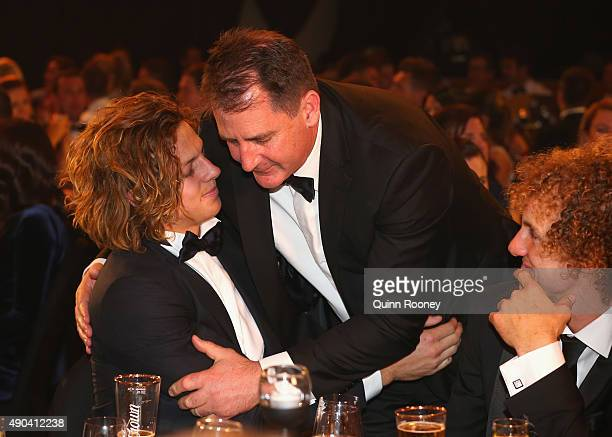 Nat Fyfe of the Dockers is congratulated by coach Ross Lyon after winning the 2015 Brownlow Medal at the 2015 Brownlow Medal at Crown Palladium on...