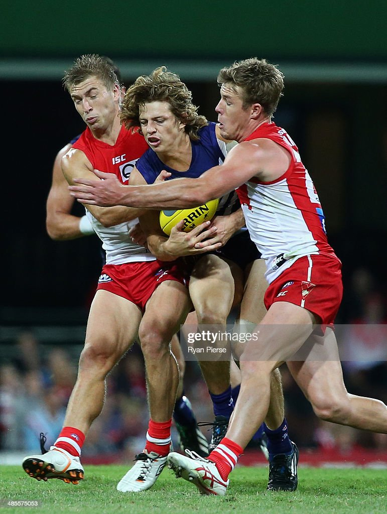 <a gi-track='captionPersonalityLinkClicked' href=/galleries/search?phrase=Nat+Fyfe&family=editorial&specificpeople=10541328 ng-click='$event.stopPropagation()'>Nat Fyfe</a> of the Dockers is tackled by Kieren Jack and Luke Parker of the Swans during the round five AFL match between the Sydney Swans and the Fremantle Dockers at Sydney Cricket Ground on April 19, 2014 in Sydney, Australia.