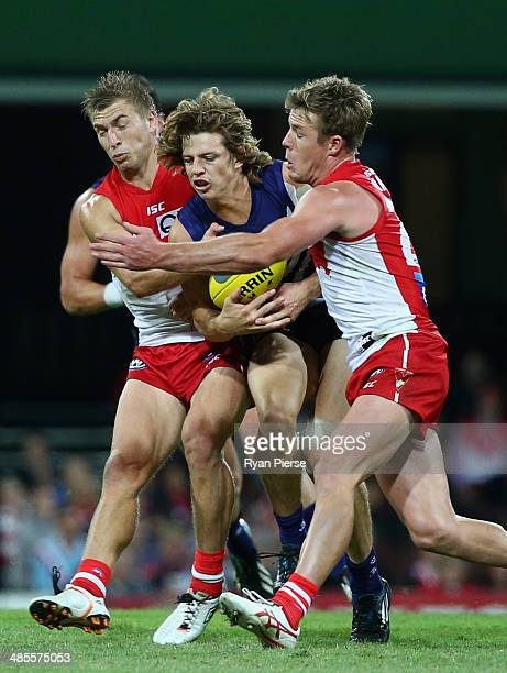 Nat Fyfe of the Dockers is tackled by Kieren Jack and Luke Parker of the Swans during the round five AFL match between the Sydney Swans and the...