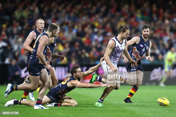 Nat Fyfe of the Dockers is tackled by Richard Douglas of the Crows during the round 10 AFL match between the Adelaide Crows and the Fremantle Dockers...