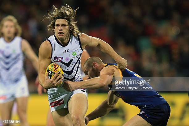 Nat Fyfe of the Dockers is tackled by Scott Thompson of the Crows during the round nine AFL match between the Adelaide Crows and the Fremantle...