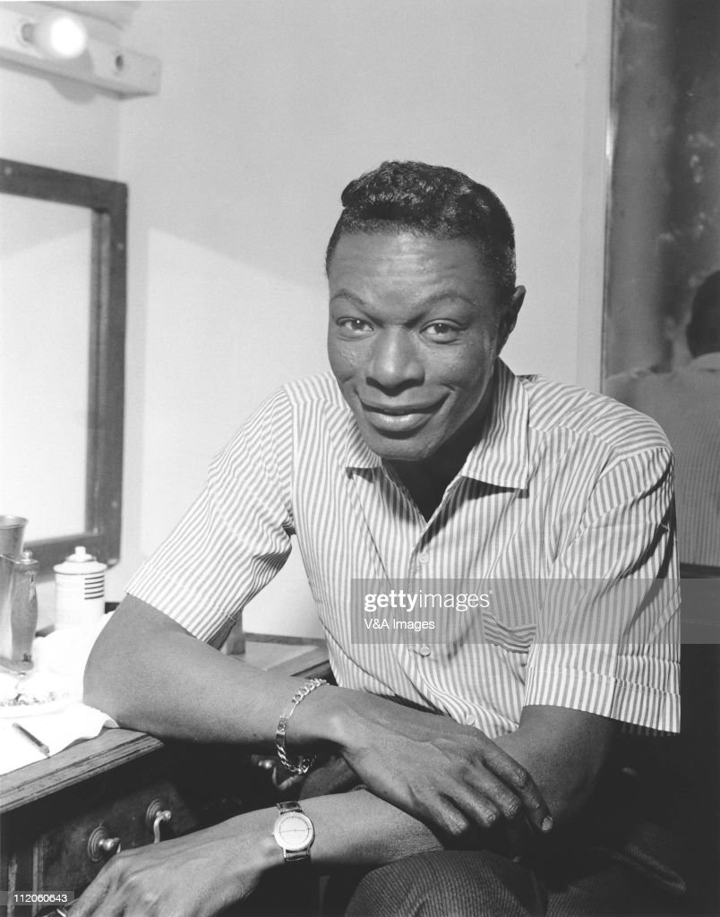 <a gi-track='captionPersonalityLinkClicked' href=/galleries/search?phrase=Nat+King+Cole&family=editorial&specificpeople=217991 ng-click='$event.stopPropagation()'>Nat King Cole</a>, posed, in dressing room, 1959.