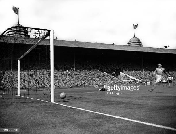 Nat Lofthouse Bolton forward is on the ground watching his shot hit the post during the Cup Final at Wembley