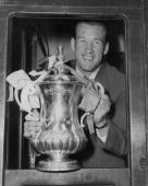 Nat Lofthouse holds the cup from the train window as Bolton Wanderers FC leave for home having won the FA cup with a 20 victory over Manchester...