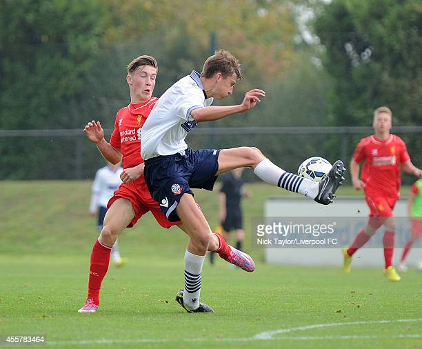 Nat Phillips of Bolton and Harry Wilson of Liverpool in action during the Barclays Premier League Under 18 fixture between Liverpool and Bolton...