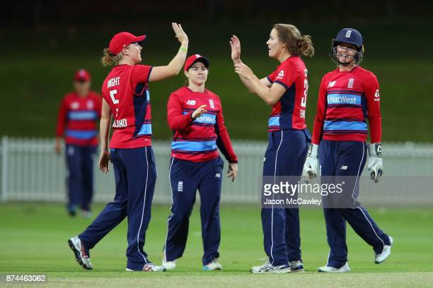 Nat Sciver of England is congratulated by Heather Knight after dismissing Georgia Wareham of the Governor General's XI during the T20 match between...