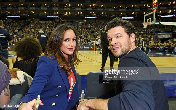 Natacha Tannous and Michael Ballack sit courtside at the NBA Global Game London 2017 basketball game between the Indiana Pacers and Denver Nuggets at...