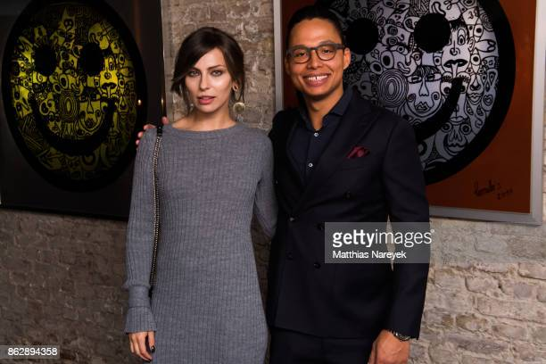 Natalia Avelon and Romulo Kuranyi during Romulo's 'Farbenspiel' exhibition opening at Hotel Provocateur on October 18 2017 in Berlin Germany